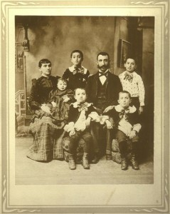 Sarah Gitel Frank holding baby- possibly Theodore? Son Philip standing to the right of her, husband John sitting. The other 3 boys are probably Joseph standing, Louis in center, and Max sitting on right.