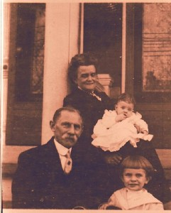 Francis and Lena (O'Brien) Helbling with their grandchildren, Edgar and Anna May Helbling.
