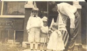 "From left: Edgar B. Helbling, (Anna) ""May"" Helbling, Vi Helbling, and Gerard William Helbling, on Flag Day 1914."