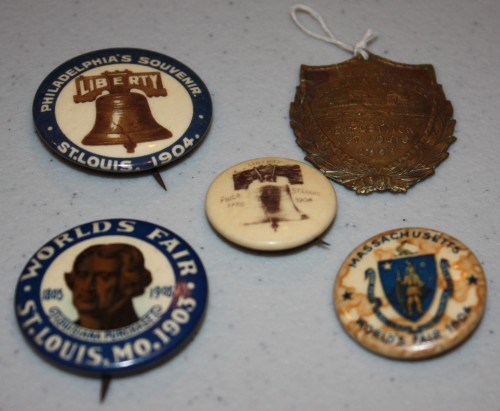 Souvenirs of 1904 St. Louis World's Fair- 4 pins plus watch fob/medal.