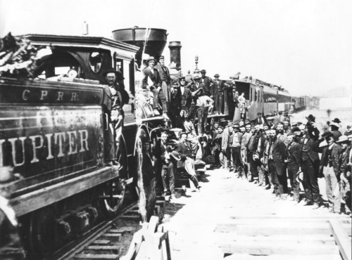 Promontory Summit, Utah- Completion of the Transcontinental railroad on 10 May 1869, via wikimedia; public domain.