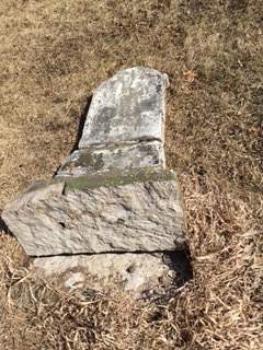Tombstone of Frederick P. Horn in Sandhill Cemetery, Cedar County, Iowa, after strong winds blew through the cemetery in March, 2016.
