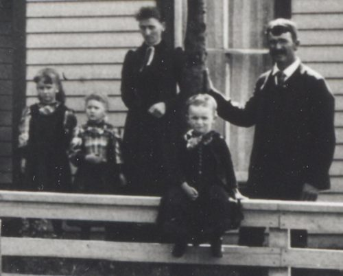 Jason Lee Roberts Family, 1892, Jasper County, Iowa. From left: Orphan B. Roberts, Oca S. Roberts, Julia (French) Roberts, Guy L. Roberts sitting on fence, and Jason Lee Roberts.