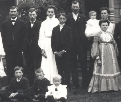 Jason Lee Roberts Family, 1900. Standing, in white dress is Orphan B. Roberts, her brother Guy L. Roberts, Jason Lee Roberts, his wife Juia (French) Roberts holding baby Ralph Roberts. Seated children, from left: Wiley Roberts, Willard Roberts, and Charley Roberts.